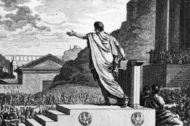 Grabado del siglo XVIII que representa a un tribuno de la plebe haciendo un discurso ante plebeyos romanos